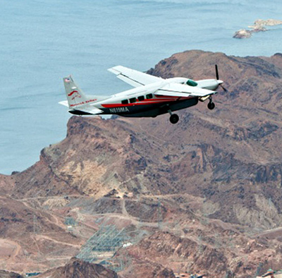Airplane flight and ground tour of the Grand Canyon- $299