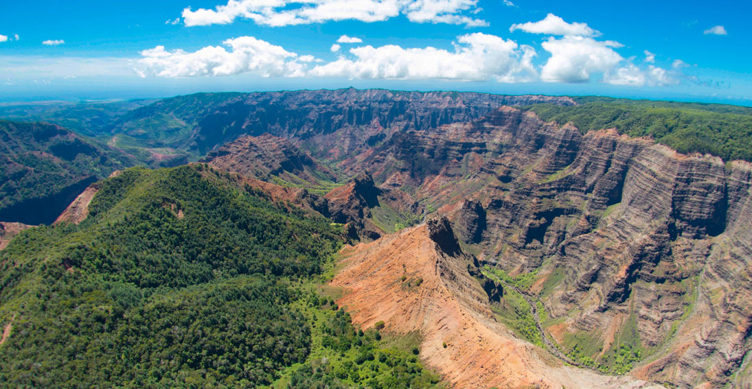 "Enjoy aerial views of Waimea Canyon, known as ""The Grand Canyon of the Pacific"""