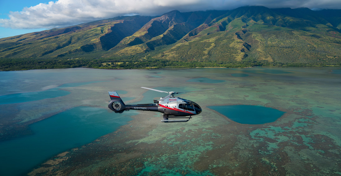 Soar over the scenic waters between Maui and Molokai