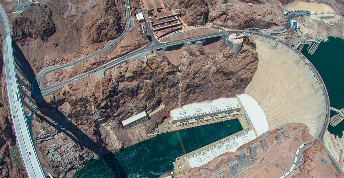 Capture aerial views of the historic Hoover Dam from inside your Maverick Helicopter