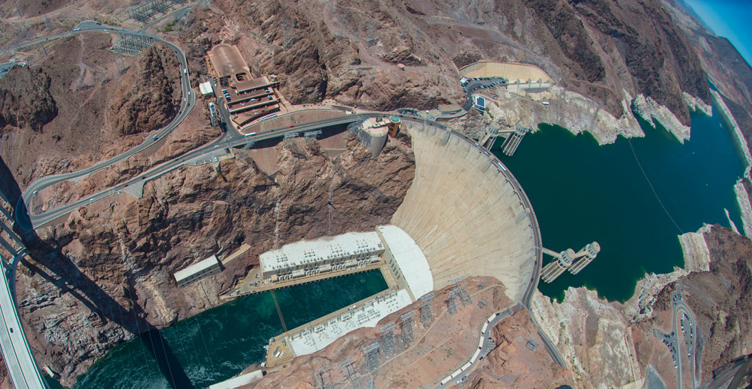 Fly over the iconic Hoover Dam on your way to the Grand Canyon
