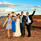 A wedding party posing at their private landing spot inside the Valley of Fire