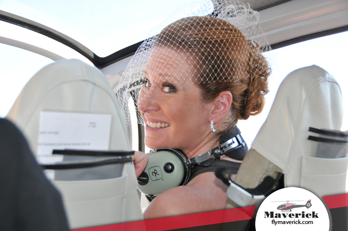 A beautiful bride inside a Maverick Helicopter.