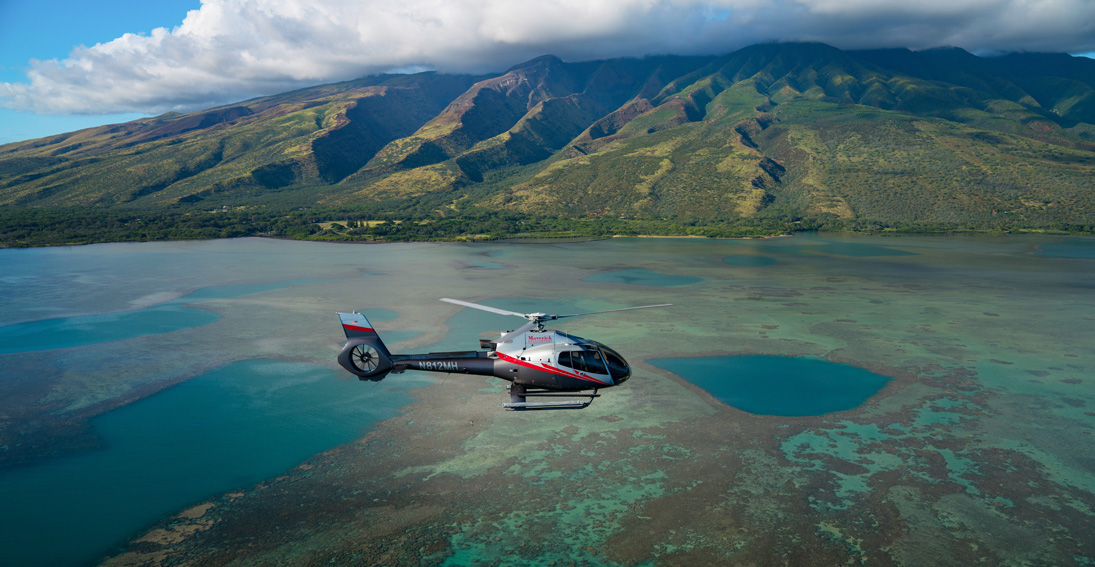 Enjoy aerial views of Molokai during your Maui wedding