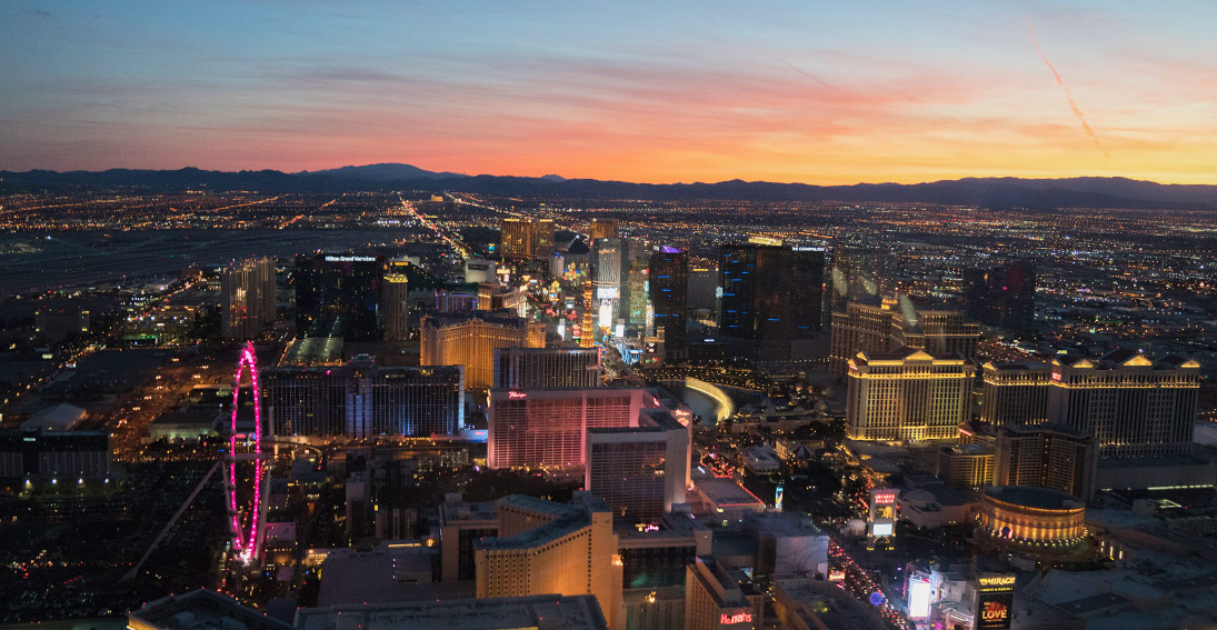 A view of desert sunset and neon lights of Las Vegas on your return flight